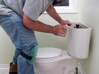 Redwood City plumbing contractor surveys a toilet